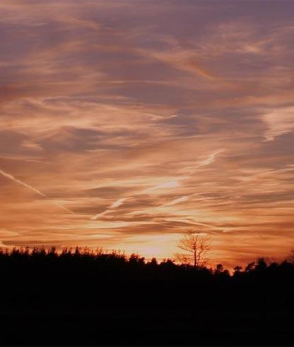 zonsondergang bij Grenzeloos en Zo